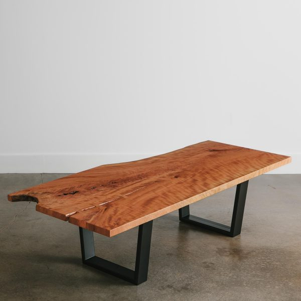 Live edge cherry coffee table with black trapezoid base