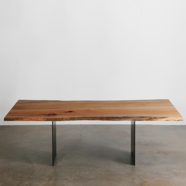 Live edge maple dining table with steel plate base