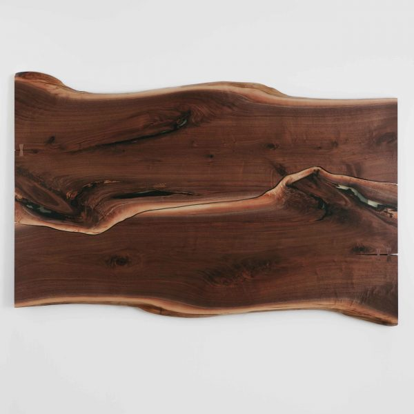 Bookmatched luxury walnut dining table live edges