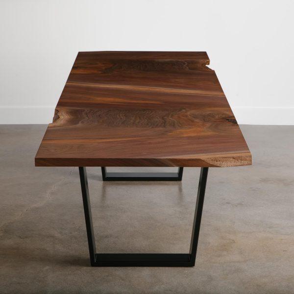 Custom walnut dining table with trapezoid base