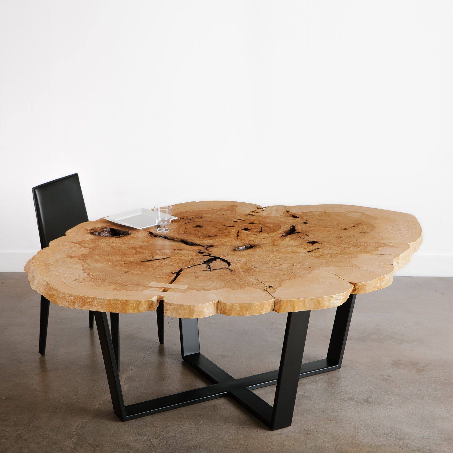 Large modern round tree trunk live edge dining table with natural knots and voids