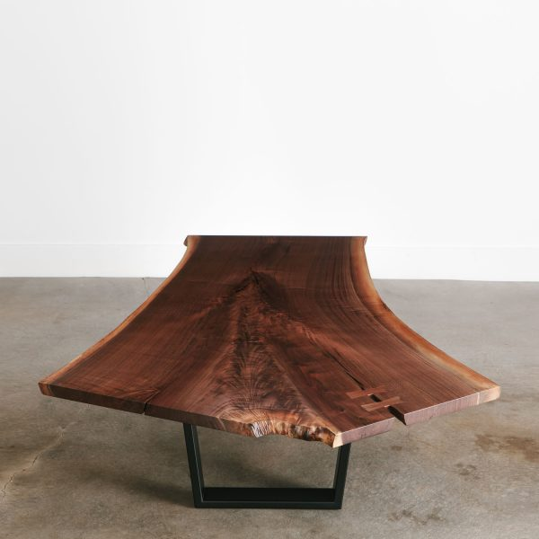 Modern live edge walnut coffee table with trapezoid base