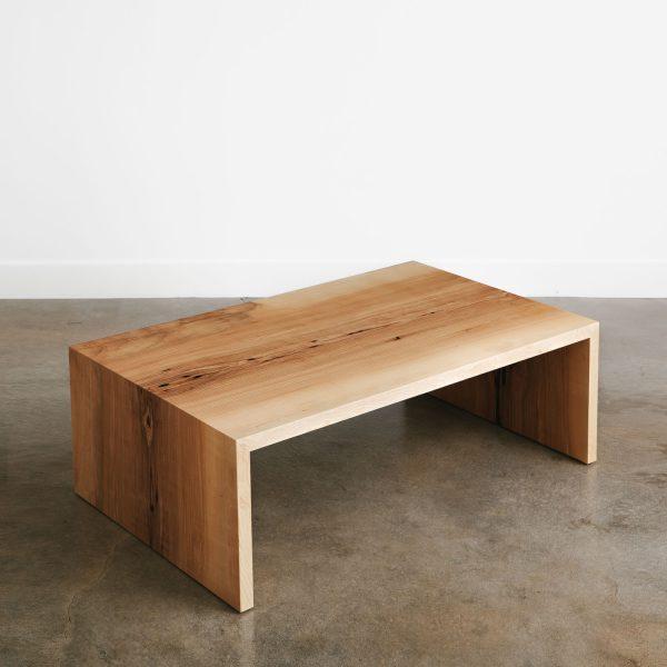 Boho chic waterfall slab coffee table in light wood