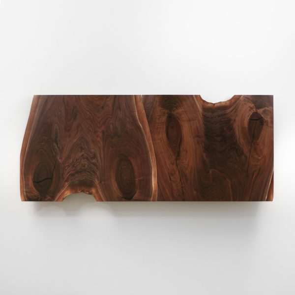 Live edge walnut slab dining room table with natural tree character