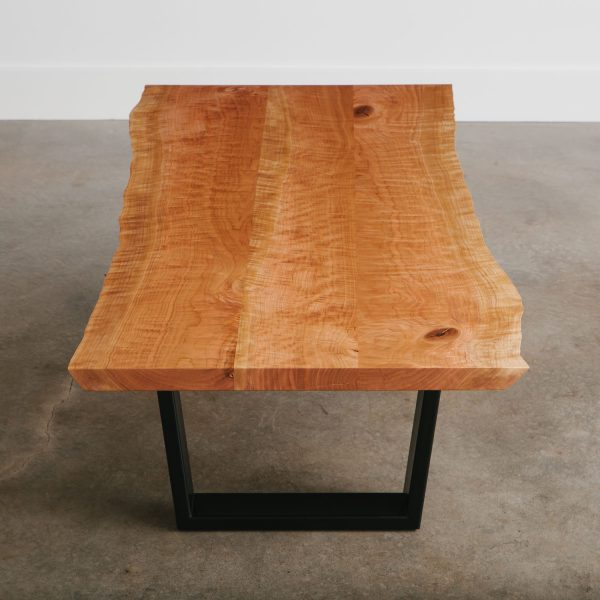 Live edge cherry coffee table with trapezoid base for city apartment
