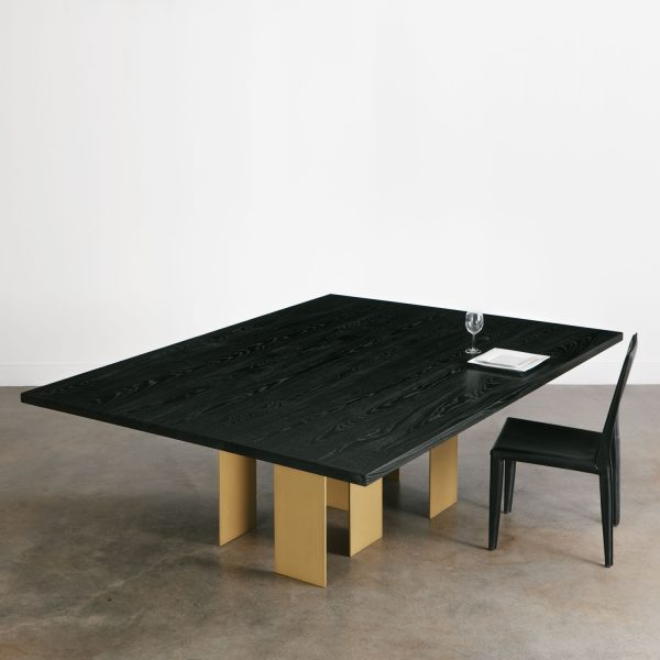 Modern blackened dining room table with brass gold base