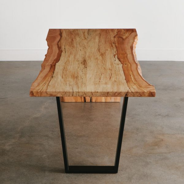 Live edge desk with black handmade trapezoid base