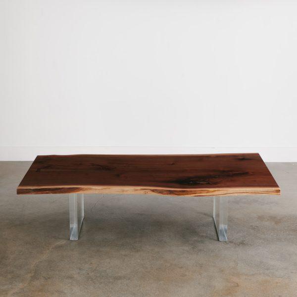 Modern luxury walnut coffee table with clear legs