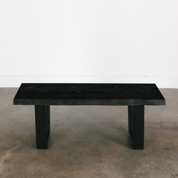Modern blackened coffee table with black base