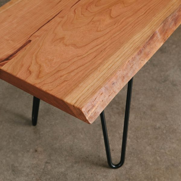 Tree slab made into bench with black skinny hairpin base