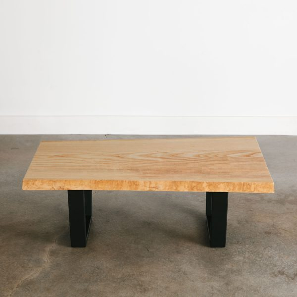 Live edge coffee table with steel base