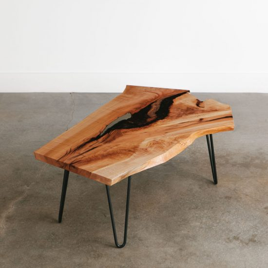 Live edge maple coffee table with contemporary thin legs