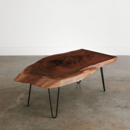 Handmade live edge walnut coffee table with black legs for city apartment