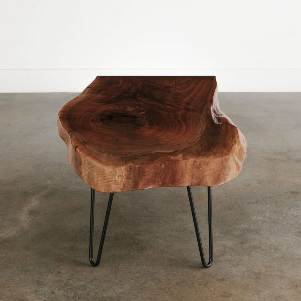 Live edge walnut slab coffee table with natural tree knot