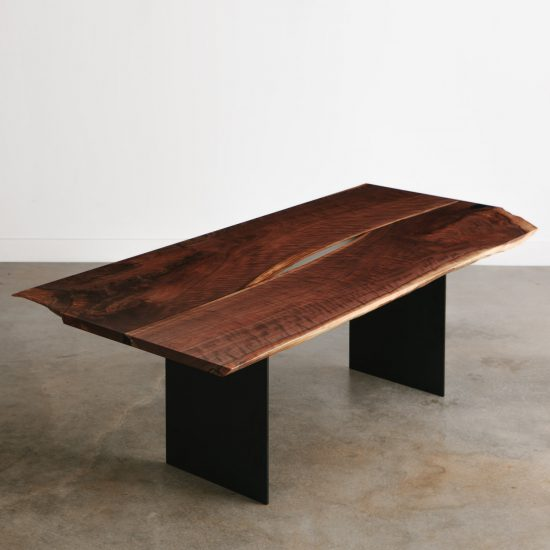 Contemporary walnut dining room table with black plate steel base