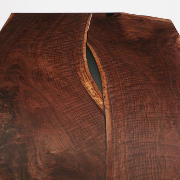 Trendy reverse bookmatch live edge slab at Elko Hardwoods furniture store