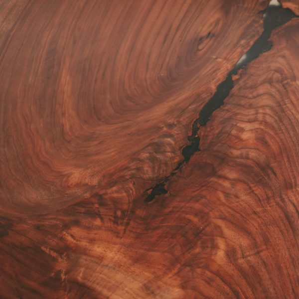 Figured walnut wood grain with clear resin at Elko Hardwoods furniture store showroom