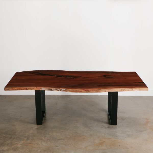 Modern walnut dining room table with black steel legs