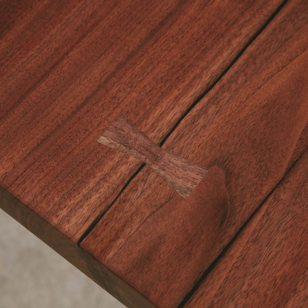 Walnut crack with butterfly joint at Elko Hardwoods furniture store showroom