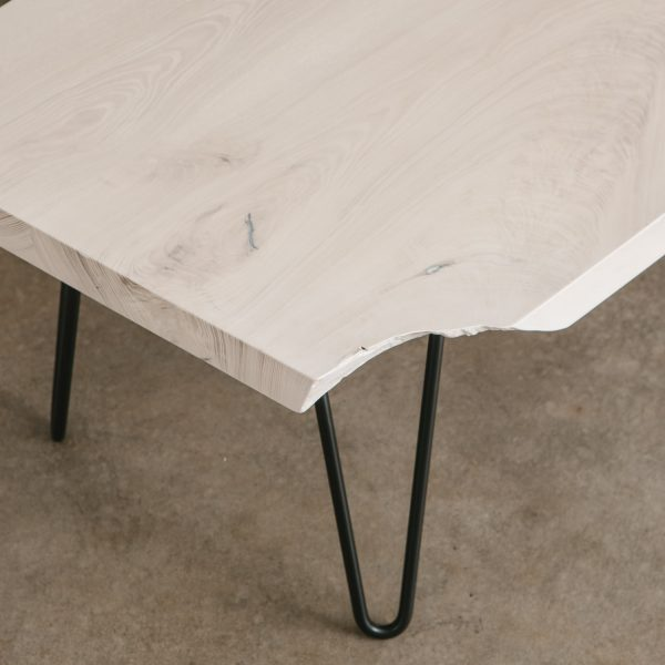 Live edge table with black hairpin legs at Elko Hardwoods furniture store