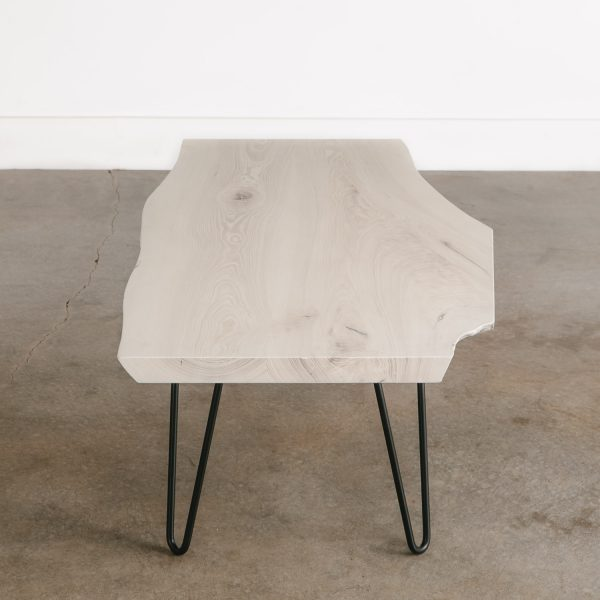 Modern whitewashed coffee table with black legs