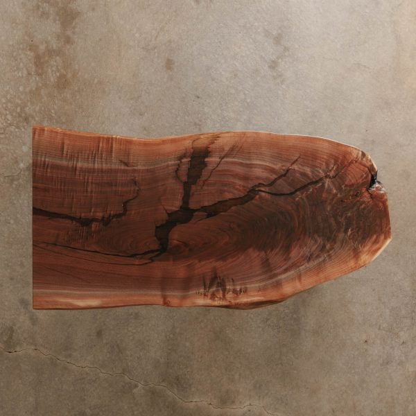Live edge walnut slab with clear resin for coworking space