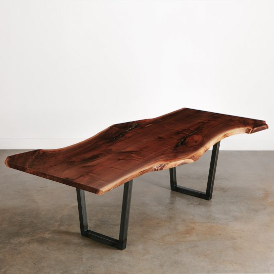 Modern live edge walnut dining room table with natural tree curves