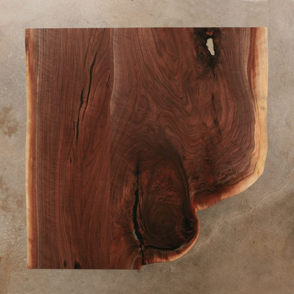 Live edge walnut coffee table slab with clear resin at Elko Hardwoods furniture store Chicago