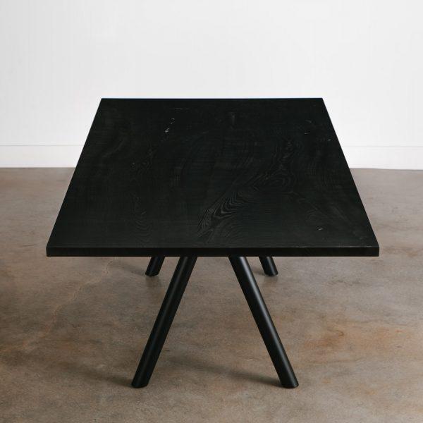 Modern hardwood blackened table with angled steel legs