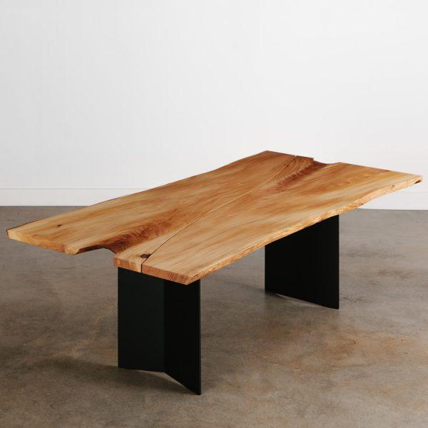 Modern live edge elm dining room table with black steel legs at Elko Hardwoods furniture store Chicago