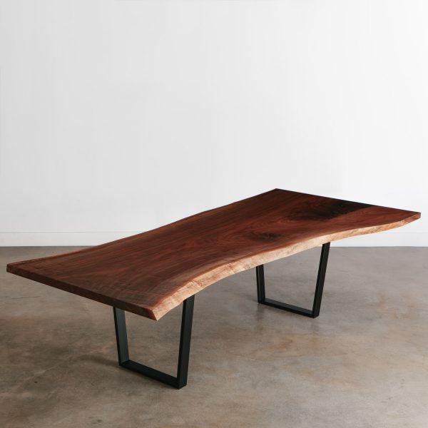 Single slab walnut live edge conference table with black steel legs