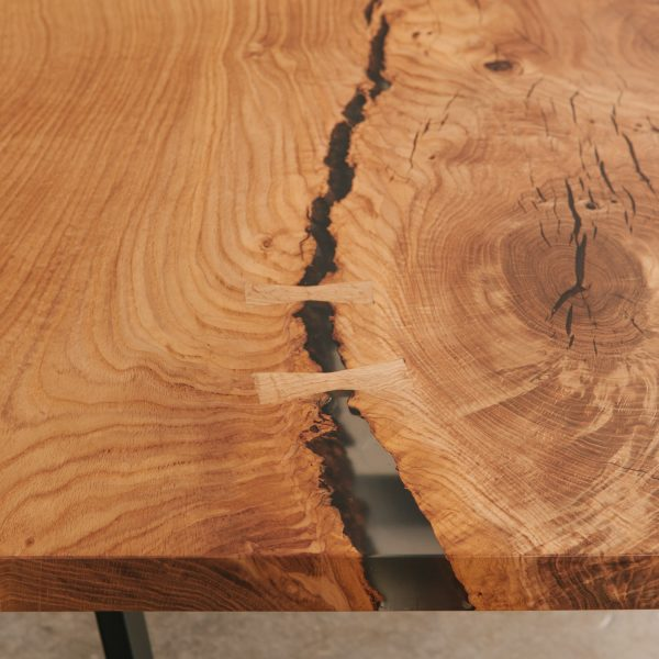 Dining table with hand cut butterfly joint
