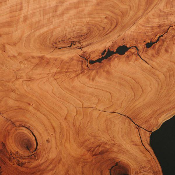 Figured cherry wood grain detail with black resin Elko Hardwoods