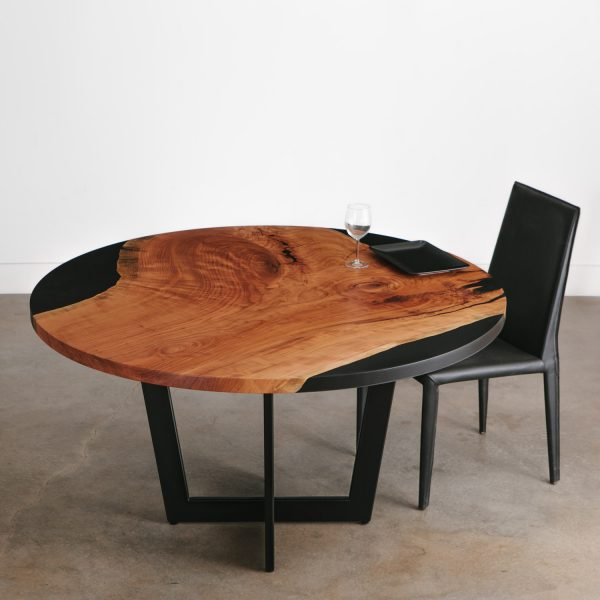 Contemporary live edge round cherry table with black resin at Elko Hardwoods Chicago