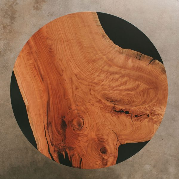 Salvaged cherry tree turned into trendy round cafe table