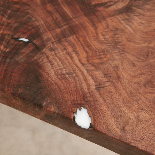 Figured walnut wood grain filled with white resin and silky smooth finish
