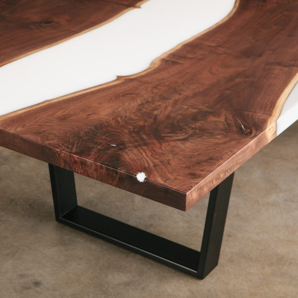 Trendy live edge walnut dining room table with white resin and black steel trapezoid base